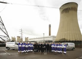 Graham is pictured (centre) at Drax Power Station in Yorkshire with his engineering team.