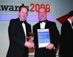 Alan Wilkinson (left) from HSBC presents IPL MD Colin Wilson with the award.