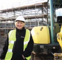 Sue Wilson lays one of the first bricks at the site of the company's new 12,000 sq metre premises.