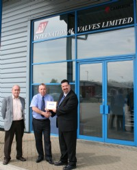 Mike  Ellis and Mark Ward-Horner of International Valves Ltd receive their plaque from BVAA Director, Rob Bartlett.