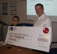 Truflo�s Managing Director, Clayton Manley presents cheque to Harry