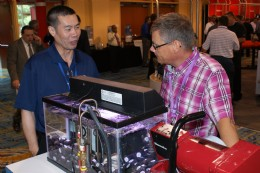 Mr Kees Meliefste from Dow (right) in discussion with a representative from GE Energy about their waterproof valve systems.