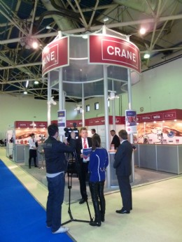 CRANE representative Dmitry Kachko speaks to a local TV station in Moscow during the 2011 Khimia Chemical Industry and Sciences Exhibition