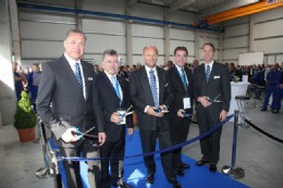 Ribbon cutting ceremony photograph (l to r):