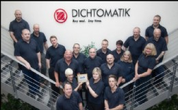 Dichtomatik staff proudly hold their plaque.