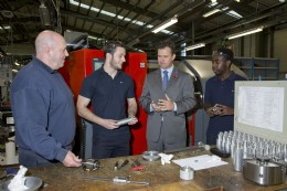 Mark Lancaster MP meeting two of SMC's current apprentices, Rhys Lloyd (2nd from left) and Jeffrey Sambadzai (right)