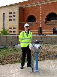 Andrew Bowkett with a Rotork IQ Actuator outside the GAC and ozone treatment building at Mythe. The pedestal mounting saved this actuator from a ducking!