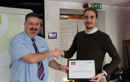 Eddie Sheard (Cohort 2) recieving a Highest Achiever Award from Rob Bartlett