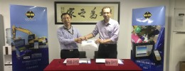 From left to right - Kern Zhang, President of Loneking signing the agreement with Martin Cuthbert, Webtec's Managing Director