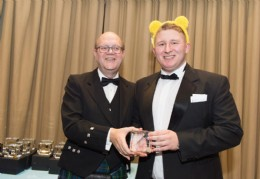 BVAA Chairman Colin Findlay presenting a crystal award to Adrian Chiechanowski