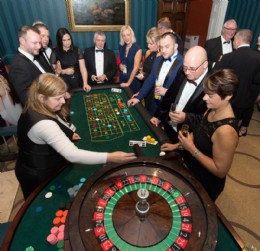 Members trying their luck on the charity Roulette table