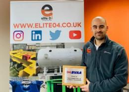 Elite 04 General Manager Stuart Lemon proudly displaying their plaque