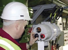 A Rotork engineer locally operates a newly installed Rotork IQT actuator during commissioning.
