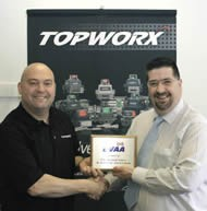 Topworx: Sales Director Tony Stark receives his plaque.