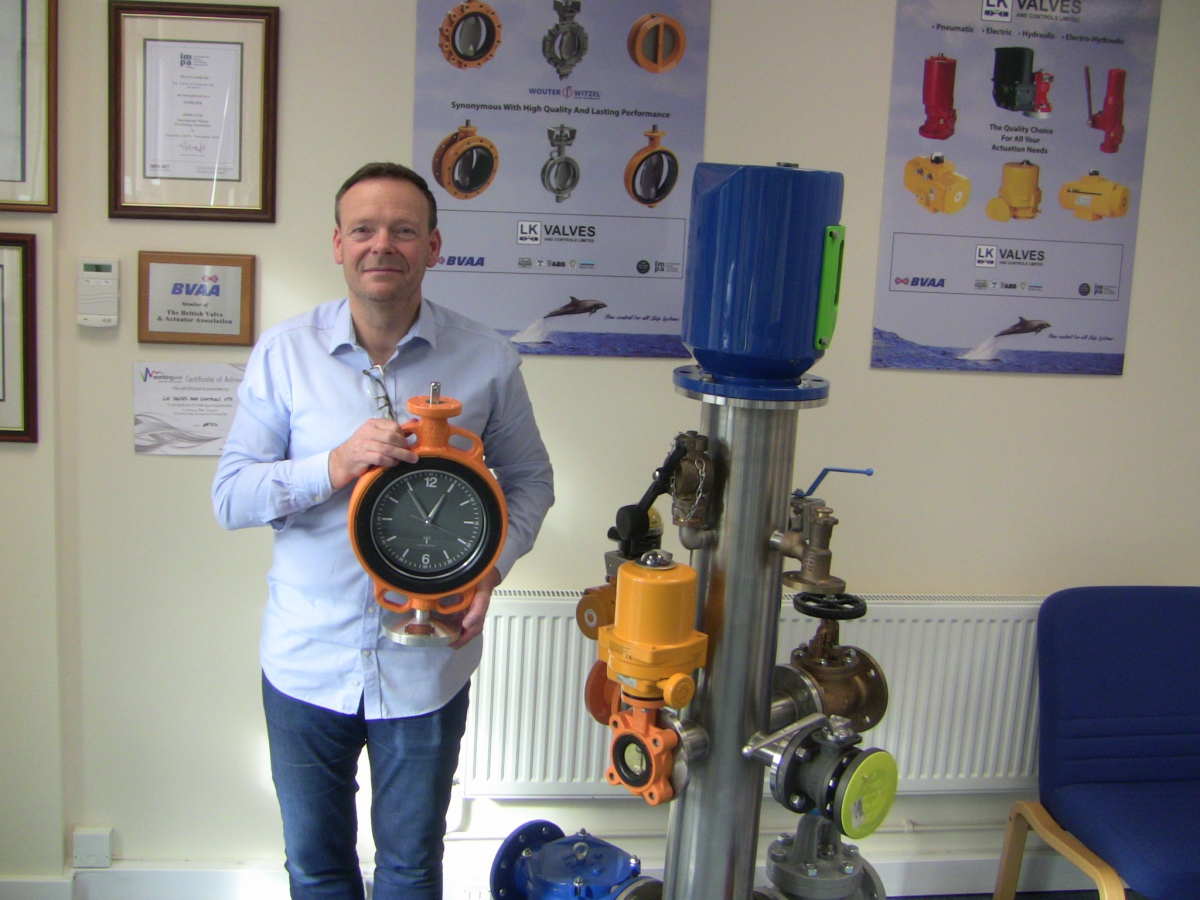 Director Colin Evans takes delivery of a custom made clock to celebrate 15 years trading. The clock face is mounted within a DN200 Wouter Witzel EVBS semi-lugged butterfly valve, finished in Wouter Witzel's trademark orange epoxy coating. It now stands pride of place in reception at LK Valves & Controls, Liverpool.
