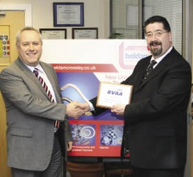 Beldam Crossley MD Mark Seekings receives his plaque